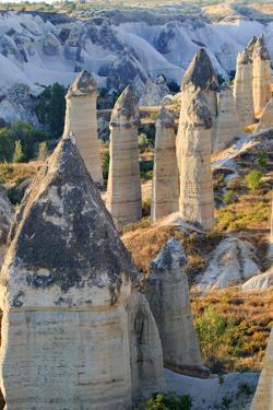 Turkey, Anatolia, Cappadocia, Goreme. 'Fairy Chimneys' in Red Valley. by Emily Wilson