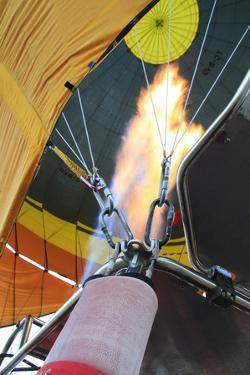 Turkey, Anatolia, Cappadocia, Goreme. Hot air balloon flames. by Emily Wilson