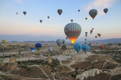 Turkey, Anatolia, Cappadocia, Goreme. Hot air balloons above Red Valley. by Emily Wilson