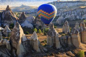 Turkey, Anatolia, Cappadocia, Goreme. Hot air balloons flying above the valley. by Emily Wilson