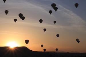 Turkey, Anatolia, Cappadocia, Goreme. Hot air balloons flying above the valley. by Emily Wilson