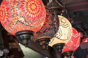 Turkey, Central Anatolia, Nevsehir Province, Uchisar, glass mosaic lamps. by Emily Wilson