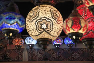 Turkey, Central Anatolia, Uchisar, colorful, glass mosaic lamps. by Emily Wilson