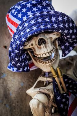 USA, Oregon, Redmond, Bend. Skeleton decorated for 4th of July. by Emily Wilson