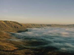 Fog over Ngorongoro Crater by Emory Kristof