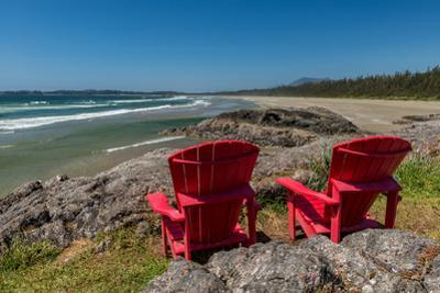 Empty red chairs at coast, Pacific Rim National Park Reserve, Vancouver Island, British Columbia...