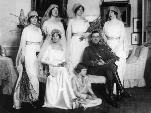 Bride and Bridegroom with Bridesmaids and Train Bearers by English Photographer