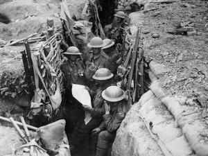 Reading a Newspaper in the Trenches, 1916-17 by English Photographer