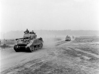 Tanks on the Move to Vire over the Tank Runs, c.1945 by English Photographer