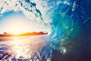Blue Ocean Wave Crashing at Sunrise by EpicStockMedia
