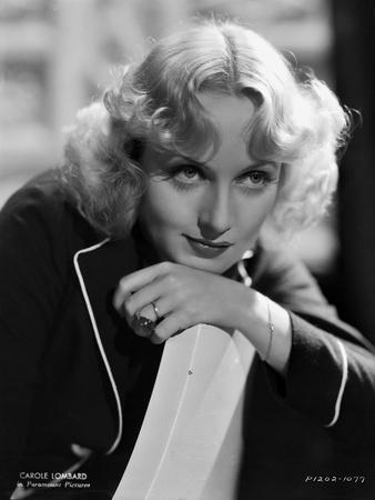 Carole Lombard in a Black Coat and Face Leaning on Hand