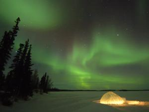 Igloo Lit Up at Night under Northern Lights Northwest Territories, Canada March 2007 by Eric Baccega