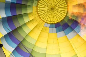 A Flame Is Visible Inside a Colorful Hot Air Balloon by Eric Kruszewski