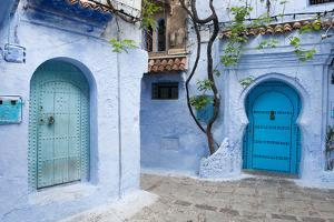 A View into the Winding and Steep Streets of Chefchaouen, the Blue City of Morocco by Eric Kruszewski