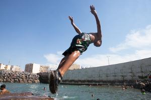 In Casablanca, a Teenage Boy Dives into a Natural Pool Formed by the City's Break-Wall by Eric Kruszewski