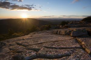 Sunset on Cadillac Mountain with a Low Angle Look across the Cracks in the Granite Fields of Maine by Eric Peter Black