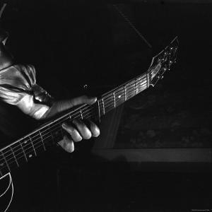 Hands of Maybelle Carter Millard Playing the Guitar by Eric Schaal