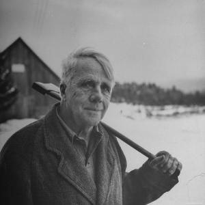 Poet Robert Frost in Affable Portrait, Axe Slung over Shoulder in Wintry Rural Setting by Eric Schaal