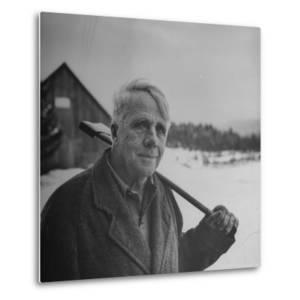 Poet Robert Frost in Affable Portrait, Axe Slung over Shoulder in Wintry Rural Setting by Eric Schaal