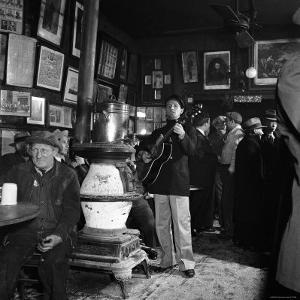 Woody Guthrie Playing in McSorley's Pub by Eric Schaal