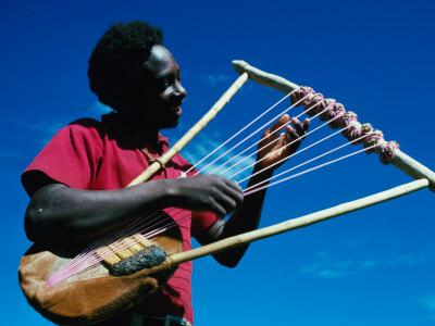 Man Playing Local Stringed Instrument at Kebirigo, Kenya