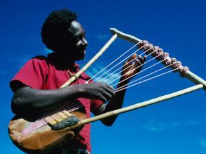 Man Playing Local Stringed Instrument at Kebirigo, Kenya by Eric Wheater