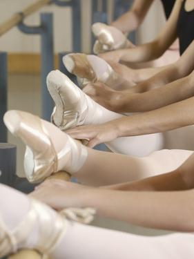 Ballerinas at the barre by Erik Isakson