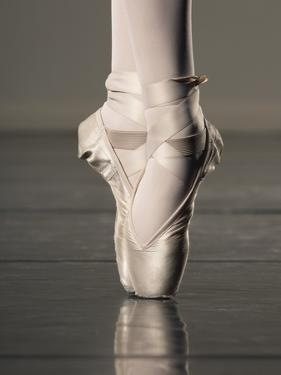 Feet of Ballet Dancer En Pointe by Erik Isakson
