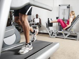 People Exercising in Health Club by Erik Isakson