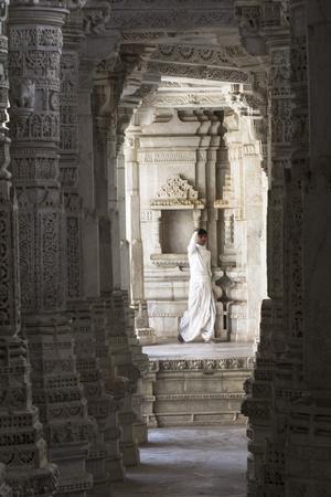 Jain Monk Amongst Ornate Marble Columns Of The Famous Jain Temple Ranakpur, Rural Rajasthan, India
