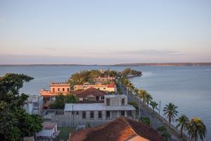 Sunset over Punta Gorda, Cienfuegos, Cuba by Erika Skogg