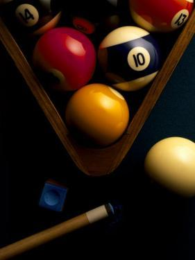 Billiard Balls, Chalk, Cue, and Rack on Table Felt by Ernie Friedlander