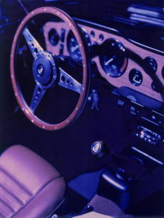 Car Dashboard, Steering Wheel, and Front Seat