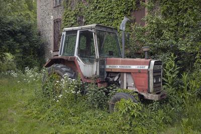 Old Massey Ferguson 698T Tractor Outside Farm Building, Norfolk, UK, June 2014