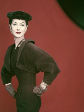 Model Nancy Berg Wearing a Brown Velvety Wool Dress by Adele Simpson by Erwin Blumenfeld