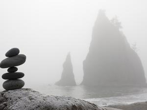 A Small Stone Cairn on Driftwood with Sea Stacks at Rialto Beach, Olympic National Park, Washington by Ethan Welty