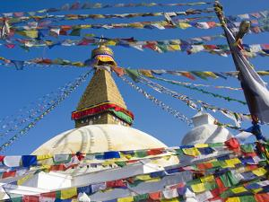 Boudhanath Stupa and Prayer Flags, Kathmandu, Nepal. by Ethan Welty
