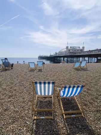 Deck Chairs and Pier, Brighton Beach, Brighton, Sussex, England, United Kingdom