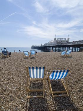Deck Chairs and Pier, Brighton Beach, Brighton, Sussex, England, United Kingdom by Ethel Davies