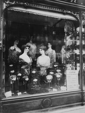 Paris, 1912 - Hairdresser's Shop Window, boulevard de Strasbourg by Eugene Atget