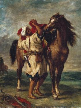 Arab Saddling His Horse by Eugene Delacroix
