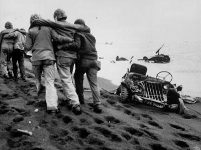 Wounded Marines Being Helped to Aid Station by Navy Corpsmen During WWII