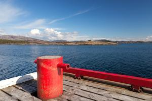 Red Mooring Bollard on Wooden Pier by Eugene Sergeev