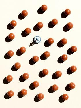 Overhead Shot of Balls and a Subbuteo Player by Eugenio Franchi