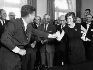 Eunice Shriver Receives a Signing Pen from Her Brother, President John Kennedy