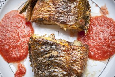 Baked Tilapia Served with Red Pepper Sauce by Eunika