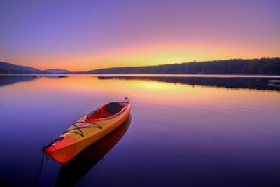 Kayak on Lake at Sunrise by EvanTravels