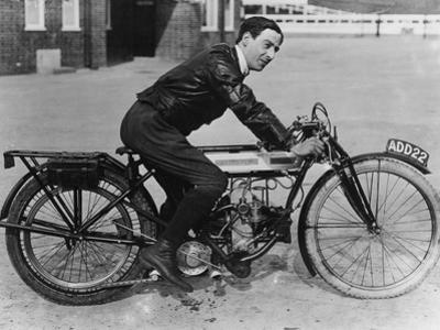 F Ball Riding a 1913 Douglas Motorbike, (C1913)