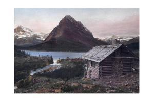 A Log Cabin Overlooks Lake Mcdermott and the Rocky Mountains by F. H. Kiser