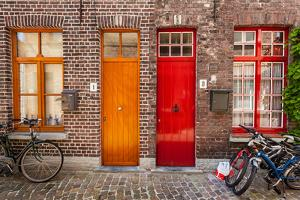 Doors of Old Houses and Bicycles in European City. Bruges (Brugge), Belgium by f9photos
